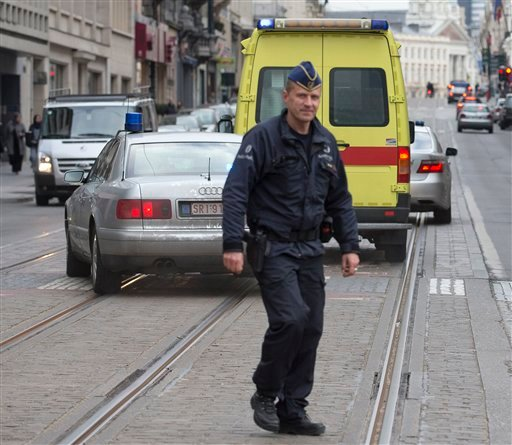 A police convoy thought to be carrying captured fugitive Salah Abdeslam leaves the federal police headquarters in Brussels, Belgium, Saturday, March 19, 2016. Abdeslam, the top suspect in last year's deadly Paris attacks, was arrested after a four-month m
