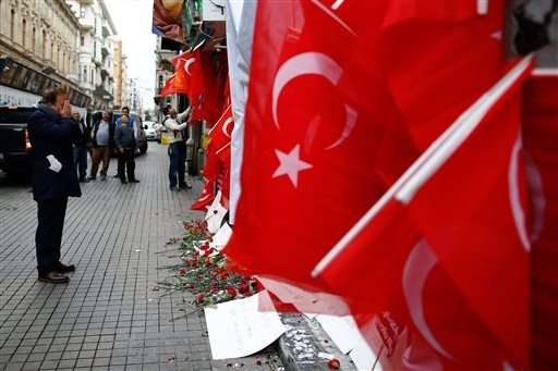 A man stands in front of the Saturday explosion site in Istanbul, Sunday, March 20, 2016. A suicide attack on Istanbul's main pedestrian shopping street Saturday killed a number of people, including two dual nationality Israeli-Americans and one Iranian c
