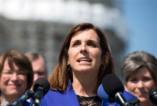 Rep. Martha McSally, R-Ariz., speaks during an event on the reinstatement of WWII female pilots at Arlington National Cemetery on Capitol Hill in Washington, Wednesday, March 16, 2016. Arlington National Cemetery approved in 2002 active duty designees, in