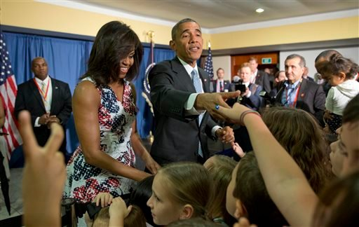 President Barack Obama, center, first lady Michelle Obama greet children and families of Embassy personnel during an event at Melia Habana Hotel, in Havana, Cuba, Sunday, March 20, 2016. (AP Photo/Pablo Martinez Monsivais)