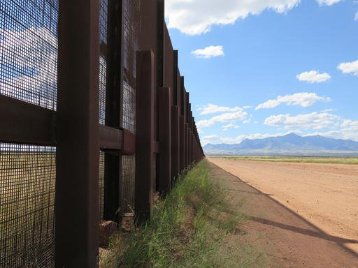 This Wednesday, Sept. 16, 2015 photo shows a part of the border fence near Naco, Ariz., during a tour of the border hosted by the Cochise County Sheriff's Office. (AP Photo/Astrid Galvan)