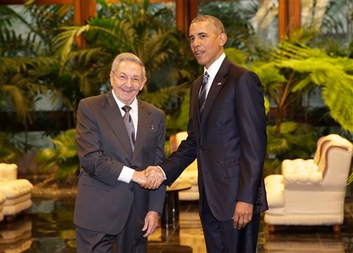 Cuban President Raul Castro, left, shakes hands with U.S. President Barack Obama during a meeting in Revolution Palace, Monday, March 21, 2016. (AP Photo/Ramon Espinosa)