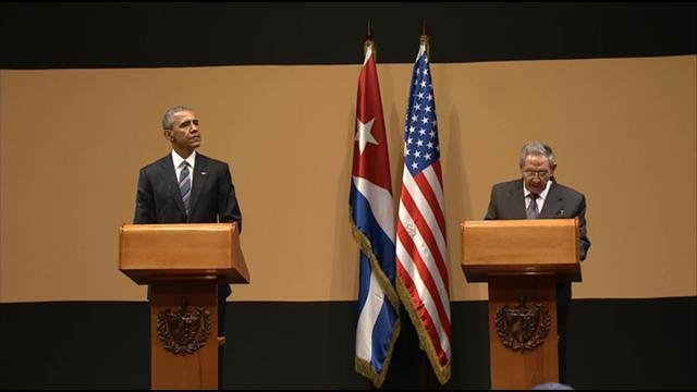 This video screen image shows President Obama and Cuban President Raul Castro delivering a joint statement Monday, March 21, 2016.