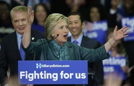 Democratic presidential candidate Hillary Clinton, center, speaks as Seattle Mayor Ed Murray, left, and his husband, Michael Shiosaki, right, look on Tuesday, March 22, 2016, during a campaign rally at Rainier Beach High School in Seattle. (AP Photo/Ted S