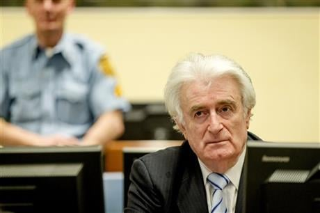 The former Bosnian-Serbs leader is indicted for genocide, crimes against humanity, and war crimes. (Robin van Lonkhuijsen, Pool via AP)