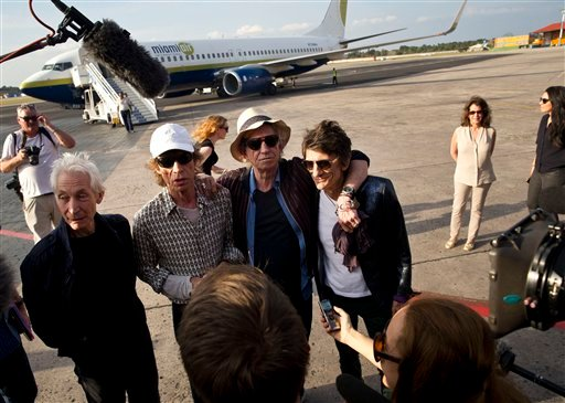 Members of The Rolling Stones, from left, Charlie Watts, Mick Jagger, Keith Richards and Ron Wood talk to journalists upon their arrival to Jose Marti international airport in Havana, Cuba, Thursday, March 24, 2016.