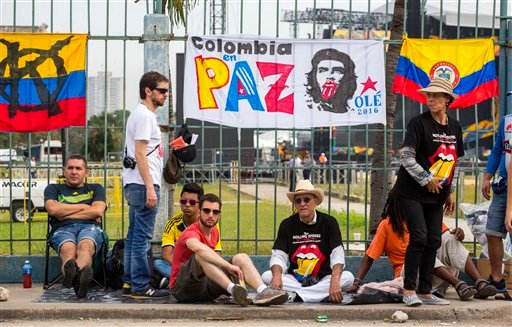 Fans wait outside the venue where the Rolling Stones will play their concert in Havana, Cuba, Friday, March 25, 2016.