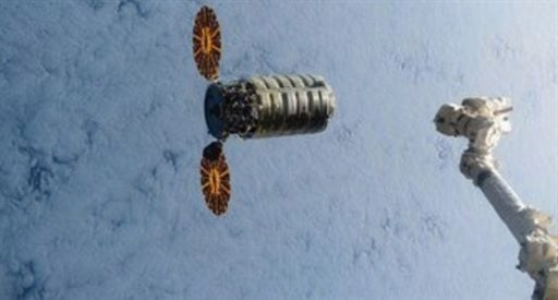 This still image taken from NASA TV shows a commercial cargo ship named Cygnus about to connect to the International Space Station on Saturday, March 26, 2016.