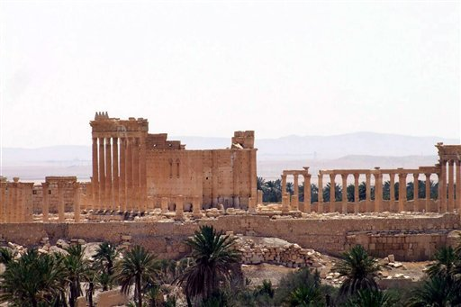 This file photo released May 17, 2015, by the Syrian official news agency SANA, shows a general view of Palmyra, Syria. Palmyra is an archaeological gem that Syrian troops took back from Islamic State fighters, Sunday, March 27, 2016. A desert oasis surro