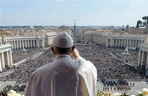Pope Francis delivers the Urbi et Orbi (to the city and to the world) message at end of the Easter mass, in St. Peter's Square, at the Vatican, Sunday, March 27, 2016. Pope Francis tempered his Easter Sunday message of Christian hope with a denunciation o