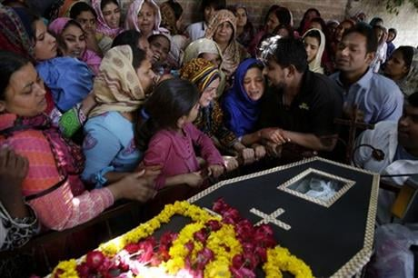 The death toll from a massive suicide bombing targeting Christians gathered on Easter in the eastern Pakistani city of Lahore rose on Monday as the country started observing a three-day mourning period following the attack. (AP Photo/K.M. Chaudary)