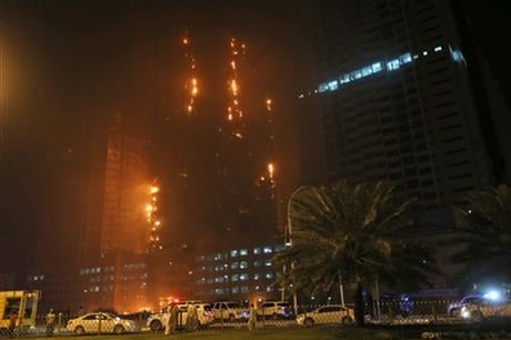 Police in the United Arab Emirates city of Ajman confirmed the fire erupted at the high-rise tower, the latest in a series of skyscraper blazes in the Gulf nation, but gave no details of casualties. (AP Photo/Kamran Jebreili)