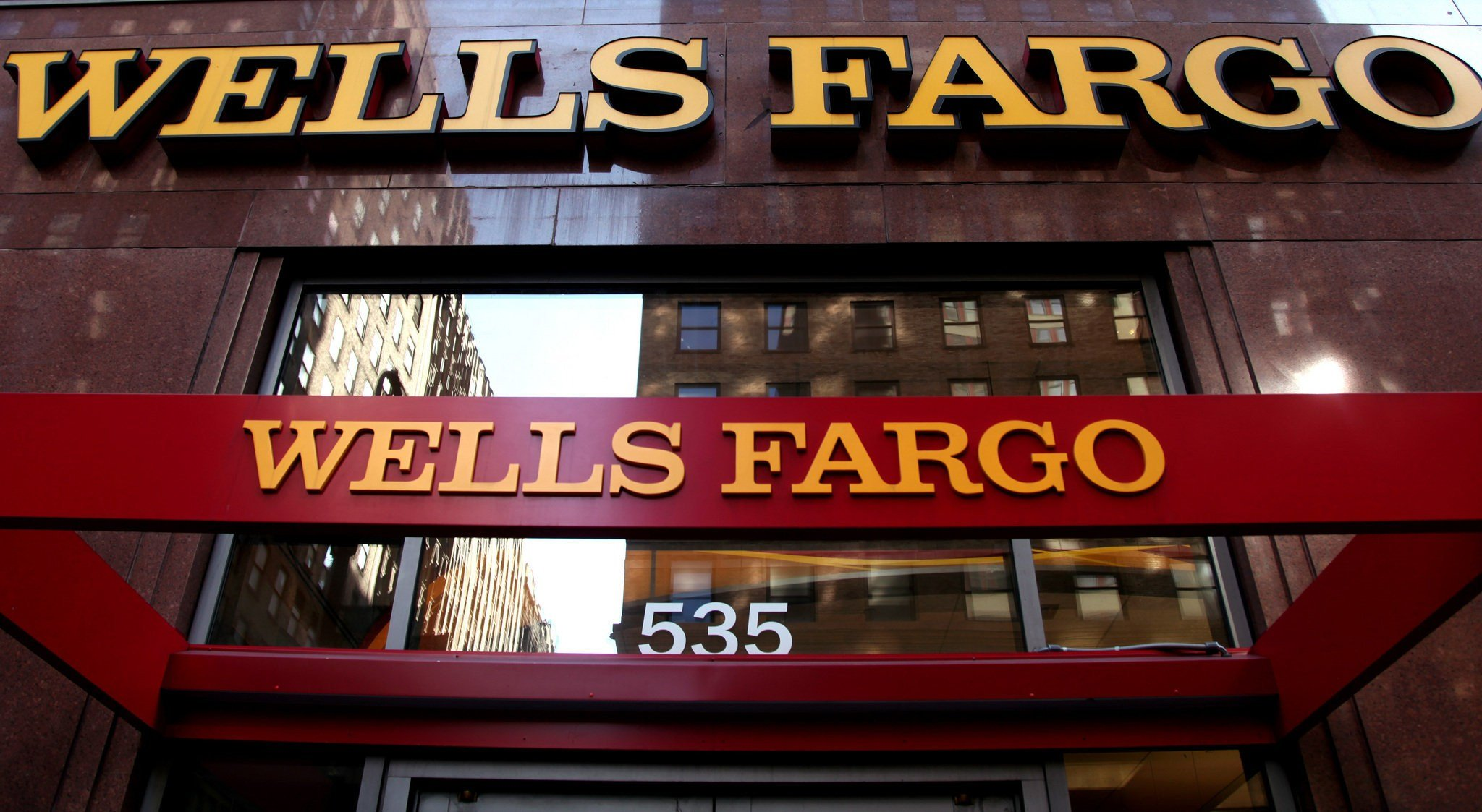 May 6, 2012, file photo: A Wells Fargo sign is displayed at a branch in New York. (AP Photo/CX Matiash, File)