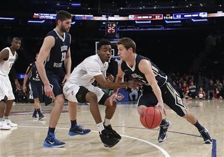 George Washington's Alex Mitola (1) drives past San Diego State's Jeremy Hemsley (42) as Patricio Garino (13) sets a pick during the second half of an NCAA college basketball game in the semifinals of the NIT on Tuesday, March 29, 2016, in New York.