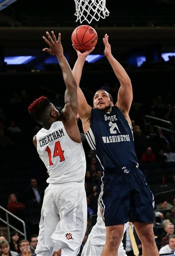 George Washington 's Kevin Larsen (21) shoots over San Diego State's Zylan Cheatham (14) during the second half of an NCAA college basketball game in the semifinals of the NIT.