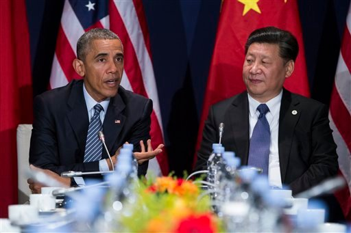 In this photo taken Nov. 30, 2015, President Barack Obama meets with Chinese President Xi Jinping in Le Bourget, France.