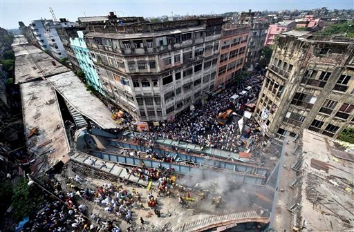 Locals and rescue workers clear the rubbles of a partially collapsed overpass in Kolkata, Thursday, March 31, 2016.
