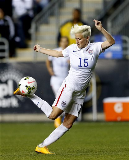 In this Oct. 24, 2014, file photo, United States midfielder Megan Rapinoe (15) against Mexico in the second half during a CONCACAF semifinal soccer match in Chester, Pa.