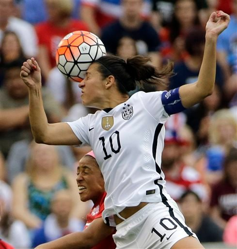 In this Feb. 21, 2016, file photo, United States' Carli Lloyd (10) and Canada's Desiree Scott (11) go up for a header during the first half of the CONCACAF Olympic women's soccer qualifying championship final in Houston.