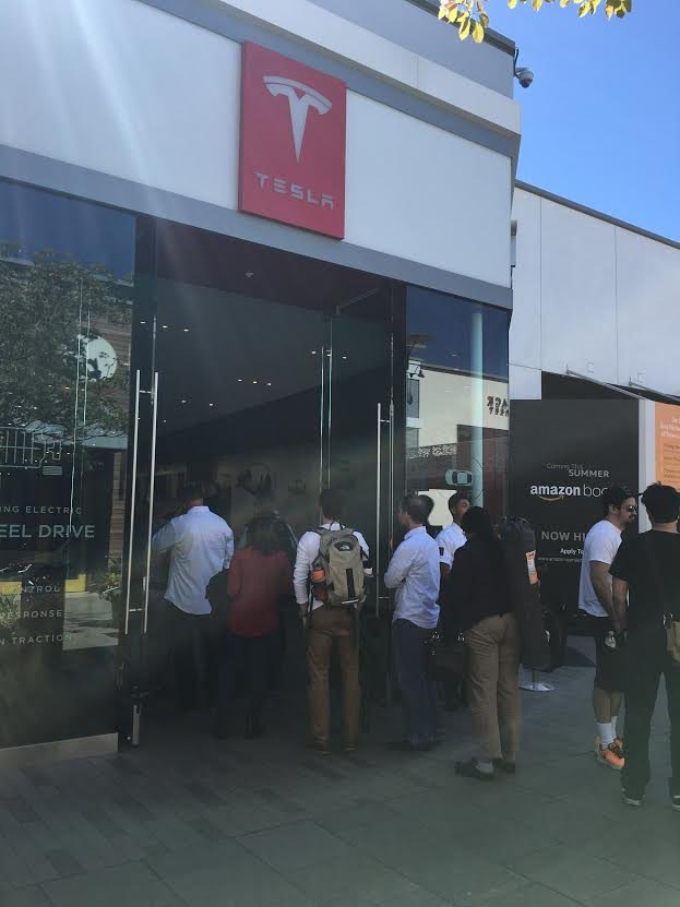Customers waiting in line at Tesla in UTC