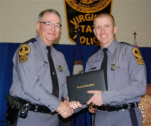 In this November 2014 photo provided by the Virginia State Police, trooper Chad P. Dermyer poses for a photo as he receives his graduation diploma from Superintendent Col. W. Steven Flaherty.