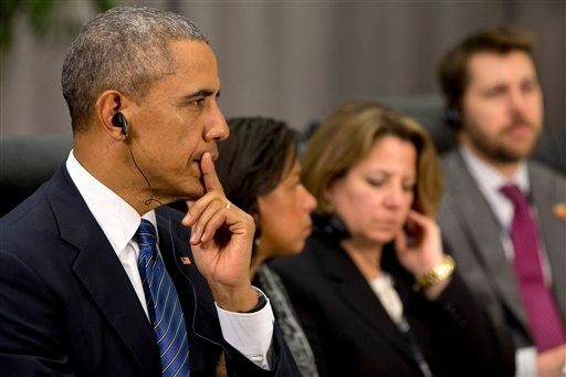 President Barack Obama listens as French President Francois Hollande speaks during their meeting at the Nuclear Security Summit in Washington, Thursday, March 31, 2016.