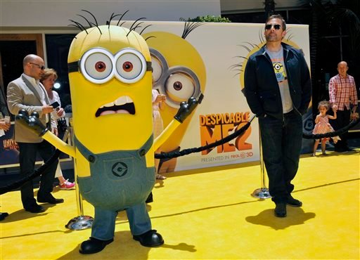 "In this June 22, 2013 file photo, Steve Carell, right, a cast member in ""Despicable Me 2,"" competes for attention on the carpet with a minion character from the film in Universal City, Calif."