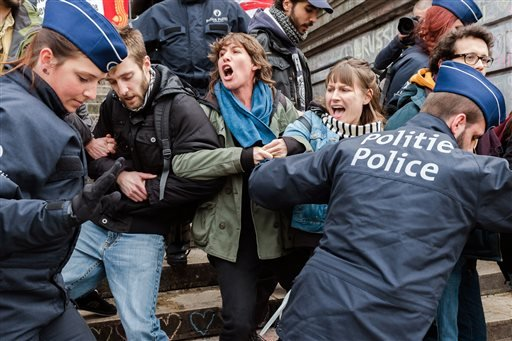 Police detain a group of people at the Place de la Bourse in Brussels, Belgium, Saturday, April 2, 2016.