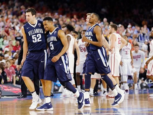 Villanova players including Phil Booth (5) and Kevin Rafferty (52) walks off the court after an NCAA Final Four tournament college basketball semifinal game against Oklahoma Saturday, April 2, 2016, in Houston. Villanova won 95-51.