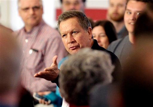 Republican presidential candidate, Ohio Gov. John Kasich talks to supporters at a campaign stop at Veterans Terrace, Saturday, April 2, 2016, in Burlington, Wis. (AP Photo/Nam Y. Huh)