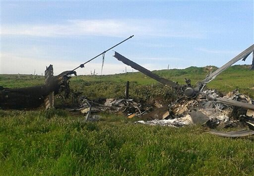 """Remains of a downed Azerbaijani forces helicopter lies in a field in the separatist Nagorno-Karabakh region, on Saturday, April 2, 2016. In a statement, Azerbaijan's Defense Ministry said 12 of its soldiers """"became shards"""" (Muslim martyrs) and said one of"""
