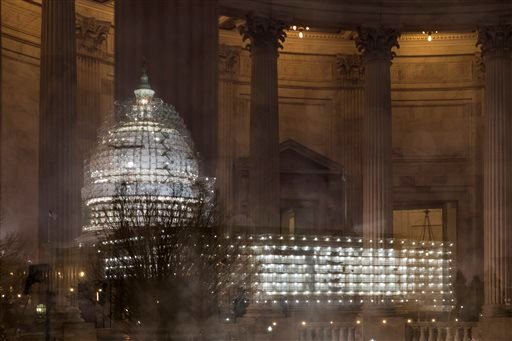 In this Feb. 24, 2016, file photo, the Capitol in Washington is illuminated during a thunderstorm with the rotunda of the Russell Senate Office Building reflected on the rain-covered windows. Congress increasingly is defined by what it's not doing this el