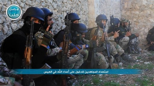 In this image posted on the Twitter page of Syria's al-Qaida-linked Nusra Front on Friday, April 1, 2016, shows fighters from al-Qaida's branch in Syria, the Nusra Front, getting ready to attack the northern village of al-Ais in Aleppo province, Syria. Th
