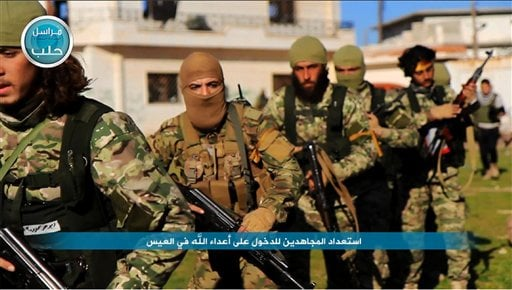 In this image posted on the Twitter page of Syria's al-Qaida-linked Nusra Front on Friday, April 1, 2016, shows fighters from al-Qaida's branch in Syria, the Nusra Front, marching toward the northern village of al-Ais in Aleppo province, Syria. The Britai