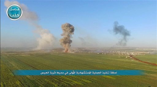 This image posted on the Twitter page of Syria's al-Qaida-linked Nusra Front on Friday, April 1, 2016, shows a Nusra Front tank firing at Syrian troops and pro-government gunmen in the northern village of al-Ais in Aleppo province, Syria. The Britain-base