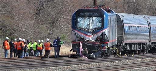 Amtrak investigators inspect the deadly train crash in Chester, Pa., Sunday, April 3 2016. The Amtrak train struck a piece of construction equipment just south of Philadelphia causing a derailment. (Michael Bryant/The Philadelphia Inquirer via AP)