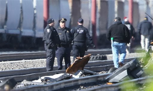 Emergency personnel stand by debris from a deadly train crash in Chester, Pa., Sunday, April 3 2016. The Amtrak train struck a piece of construction equipment just south of Philadelphia causing a derailment. (Michael Bryant/The Philadelphia Inquirer via A