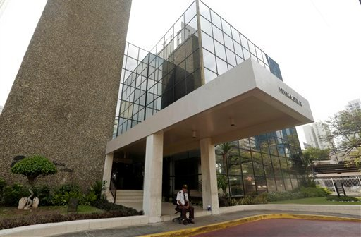 A security guard sit outside the Mossack Fonseca law firm in Panama City, Sunday, April 3, 2016. German daily Sueddeutsche Zeitung says it has obtained a vast trove of documents detailing the offshore financial dealings of the rich and famous. The Interna