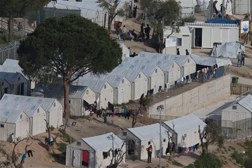Migrants and refugees inside Moria camp 0n the Greek island of Lesbos, Sunday, April 3, 2016. More than 3,000 people stay in the camp as the plan to send back migrants from Greece to Turkey is set to be implemented starting Monday. (AP Photo/Petros Gianna