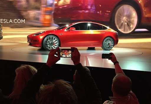 Tesla Motors unveils the new lower-priced Model 3 sedan at the Tesla Motors design studio in Hawthorne, Calif., Thursday, March 31, 2016.