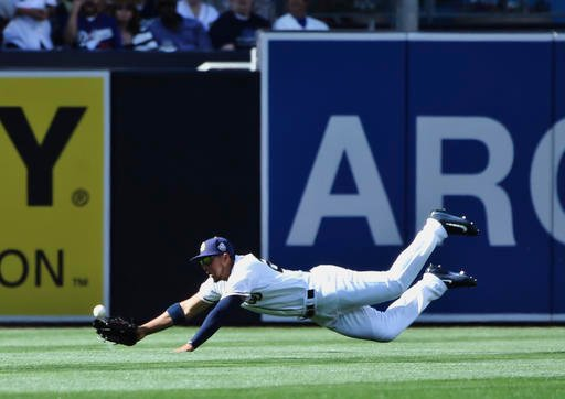 San Diego Padres center fielder Jon Jay misses a diving attempt for a double hit by Los Angeles Dodgers' Chase Utley in the first inning of a baseball game Monday, April 4, 2016, in San Diego. (AP Photo/Lenny Ignelzi)