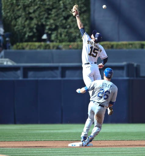 San Diego Padres second baseman Cory Spangenberg makes a leaping attempt for an overthrow as Los Angeles Dodgers' Chase Utley comes into second during the first inning of a baseball game Monday, April 4, 2016, in San Diego. (AP Photo/Lenny Ignelzi)