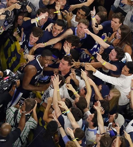 Villanova forward Kris Jenkins celebrate with fans after the NCAA Final Four tournament college basketball championship game against North Carolina, Monday, April 4, 2016, in Houston.