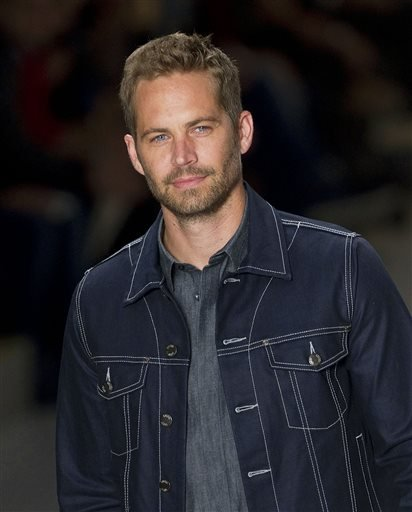 FILE - This March 21, 2013 file photo shows U.S. actor Paul Walker wearing a creation from the Colcci summer collection at Sao Paulo Fashion Week in Sao Paulo, Brazil.