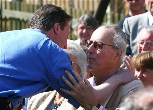 This is a March 18, 2010 file photo of Britain's Prime Minister David Cameron, left, as he greets his father Ian Cameron, in Swindon England. British Prime Minister David Cameron was under pressure Tuesday April 4, 2016 to crack down on offshore tax haven