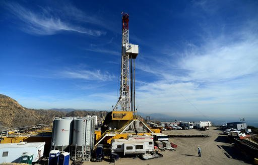 In this Dec. 9, 2015, file photo, crews work on stopping a gas leak at a relief well at the Aliso Canyon facility above the Porter Ranch area of Los Angeles. Energy officials say a natural gas well blowout last year that crippled a major energy supply for