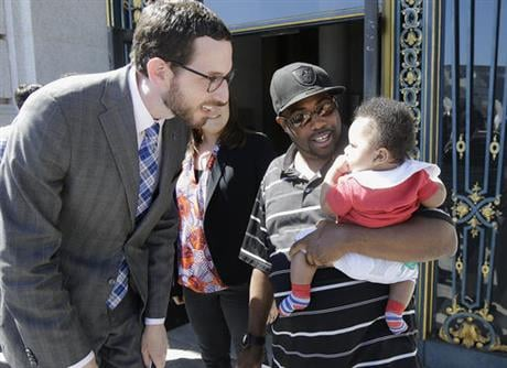 The San Francisco Board of Supervisors is voting on whether to require six weeks of fully paid leave for new parents - a move that would be a first for any jurisdiction. (AP Photo/Jeff Chiu)