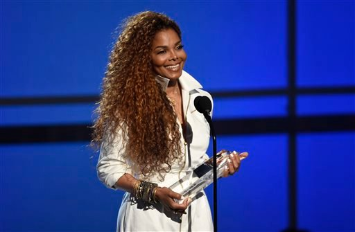 FILE - In this June 28, 2015, file photo, Janet Jackson accepts the ultimate icon: music dance visual award at the BET Awards at the Microsoft Theater in Los Angeles.