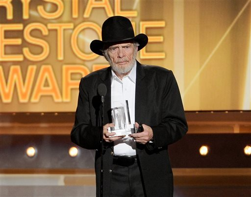 April 6, 2014 file photo, Merle Haggard accepts the crystal milestone award at the 49th annual Academy of Country Music Awards in Las Vegas.Haggard died of pneumonia, April 6, 2016, in Palo Cedro, Calif. (Photo by Chris Pizzello/Invision/AP, File)