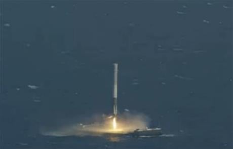 In this image made from video provided by SpaceX, the unmanned Falcon rocket lands on a barge in the Atlantic Ocean on Friday, April 8, 2016. SpaceX resumed station deliveries for NASA on Friday, and in a double triumph, successfully landed its booster ro